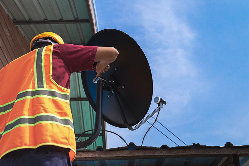 man-in-high-vis-jacket-fitting-tv-satelite